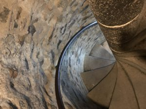 A spiral staircase seen from above.